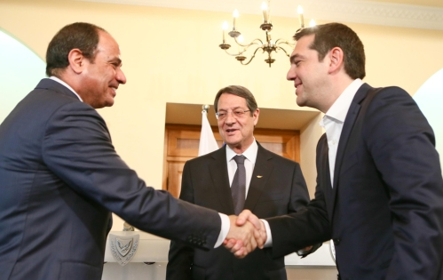 epa04725438 A Cypriot Press and Information Office handout photograph shows President of the Republic of Cyprus, Nikos Anastasiades (C), Egyptian President Abdel Fattah al-Sisi  (L) and Greek Prime Minister Alexis Tsipras (R) shaking hands after the press conference in Nicosia, Cyprus, 29 April 2015. Cyprus, Greece and Egypt are holding a follow-up Cyprus-Greece-Egypt tripartite economic relations meeting on shipping, tourism and energy in Nicosia  aimed at establishing greater cooperation in the eastern Mediterranean.  EPA/CYPRIOT PRESS OFFICE / HANDOUT  HANDOUT EDITORIAL USE ONLY/NO SALES